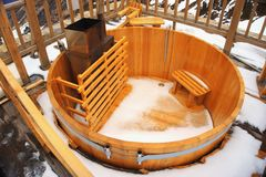 Empty wood tub in snowy day. Empty wood tub or chan in snowy day on ski resort stock images