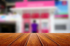 Empty wooden for advertising board on blur atm machine and customer Stock Image