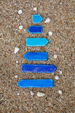 Empty wooden arrows with shells on the beach in Stock Images