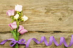 Empty wooden background with colorful flowers and purple ribbon Stock Photography