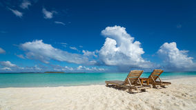 Empty wooden beach chairs on the tropical beach, vacation. Trave. Ler dreams concept Royalty Free Stock Photography
