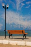 Empty wooden bench. Looking out to sea Stock Image