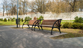 Empty wooden bench in the city park Stock Image