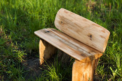 Empty wooden bench. In green grass Stock Image