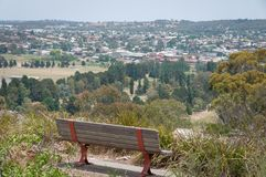 Empty wooden bench on nature lookout, view point royalty free stock image
