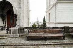 Empty wooden  bench. Empty wooden   bench near  the street building Royalty Free Stock Image