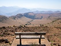 Free Empty Wooden Bench Overlooking Mountains And Arid Landscape Of Malolotja Nature Reserve, Swaziland, Southern Africa Stock Photography - 121968702