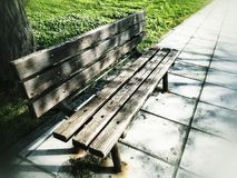 Empty wooden bench at park. An empty wooden bench at park Stock Photography