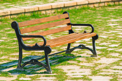 Empty wooden bench standing in the park Stock Image