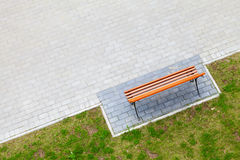 Empty wooden bench stands in park, top view Stock Photos