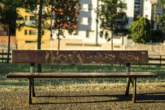 Empty wooden bench on a urban furniture still Stock Image