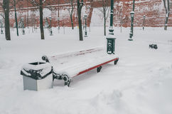 Empty wooden benches under snow Royalty Free Stock Photo