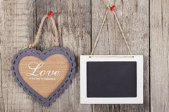 Empty wooden blackboard sign and heart shape frame Royalty Free Stock Image