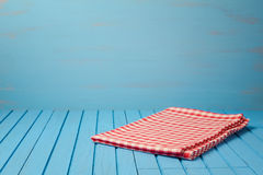 Empty wooden blue table with tablecloth. Stock Image