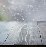Empty wooden with blurred rain background. stock photos