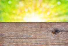 Empty wooden board with abstract summer background Stock Image