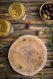 Empty wooden board with blank space for text with olives stock photography