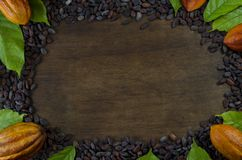 Empty wooden Board with Cocoa Pods, Beans and Leaves Stock Images