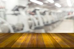 Free Empty Wooden Board Space Platform With Blur Fitness Gym Equipmen Royalty Free Stock Images - 125224659