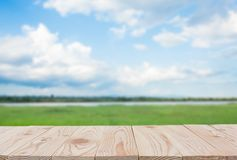 Free Empty Wooden Board Table Top On Of Blurred Blue Sky And River  Background. With Copy Space For Display Or Montage Your Products Royalty Free Stock Images - 154297879