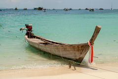 Empty wooden boat anchored Royalty Free Stock Images