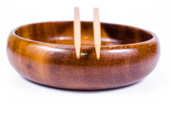 Empty wooden bowl with chopsticks on white background Royalty Free Stock Photography