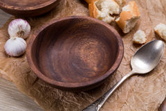 Empty wooden bowl on crushed brown paper stock images
