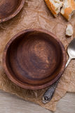 Empty wooden bowl on crushed brown paper Royalty Free Stock Photo