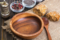 Empty wooden bowl and spoon for eating on old boards royalty free stock photography