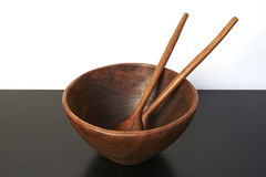 Empty wooden bowl with spoon and fork Stock Images