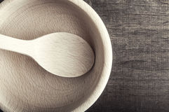 Empty wooden bowl on wooden background Royalty Free Stock Image