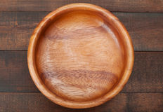 Empty Wooden Bowl on wooden table Stock Image
