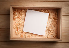 Empty wooden box with blank paper Royalty Free Stock Image