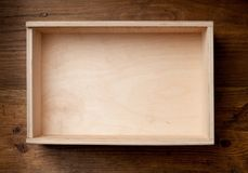 Empty wooden box on brown background. Stock Photography