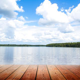 Empty wooden bridge and riverwith blue sky Royalty Free Stock Photo