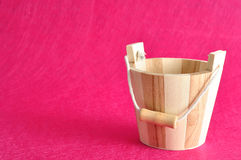 An empty wooden bucket. Isolated on a pink background Stock Photography