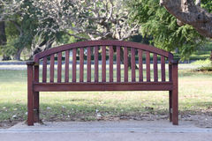 Empty wooden chair or old wood bench in the garden. Royalty Free Stock Photo