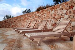 Empty wooden Chairs. Wooden chairs on natural stone terrace Royalty Free Stock Photography