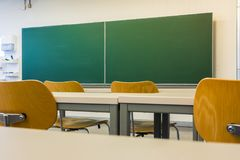 Empty Wooden Chairs at Tables Depth of Field Lecture Hall Nobody Royalty Free Stock Photos