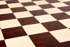 Empty wooden chess board Royalty Free Stock Photos