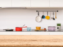 Empty wooden counter top. With kitchen background royalty free stock photos