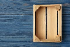 Empty wooden crate on color background, top view. With space for text stock photography