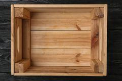 Empty wooden crate on dark background. Top view stock photo
