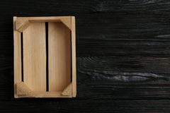 Empty wooden crate on dark background, top view. With space for text stock photography