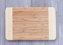 Empty wooden cutting board Stock Image