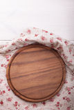 Empty wooden cutting board pizza on tablecloths Royalty Free Stock Photo