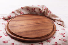 Empty wooden cutting board pizza on tablecloths Royalty Free Stock Images