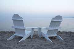 Empty wooden deck chairs on a beach Stock Photography