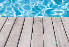 Empty wooden deck by the swimming pool Stock Images