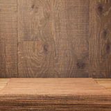 Empty wooden deck table with bamboo placemat over rustic background Royalty Free Stock Photos